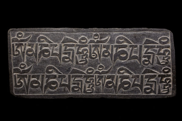 Mani Stone on black background Black Buddha Buddhism Carved Stones Carving Himalayas Inscription Kathmandu Mani Mani Stone Mantra Mantras Meditation Nepal OM Om Mani Padme Hum Prayer Sanskrit Stone Text Tibet Tibetan  Tibetan Buddhism