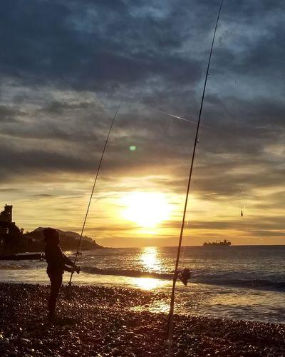 pescare all'alba Genova Sturla Pescare Alba Mare Pescatore Sunset Swing Cloud - Sky Sea Water Sky Sun Nature Beauty In Nature