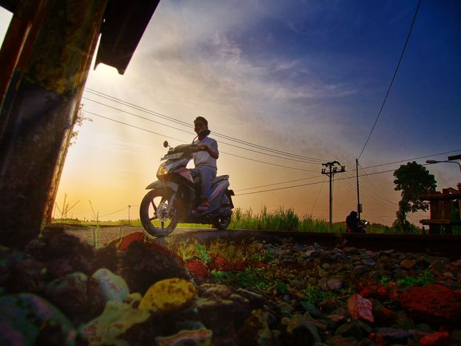a brand new day Be. Ready.  Village Village Life Village Photography INDONESIA Sunrise Sunrise_sunsets_aroundworld Motorcycle Working Streetphotography Adult Two People Men Sky Day Boys