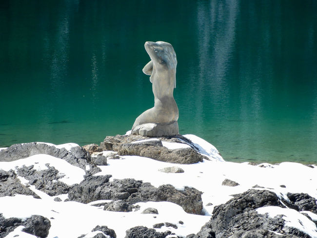 Carezza Carezza Lake Dolomites Dolomites, Italy Reflection Sea Watercolour Sky Reflection Statue Südtirol Beauty In Nature Dolomites, ıtaly Nature Outdoors Rock - Object Sculpture Sea Water Sitting Snow Südtirol Italy Water