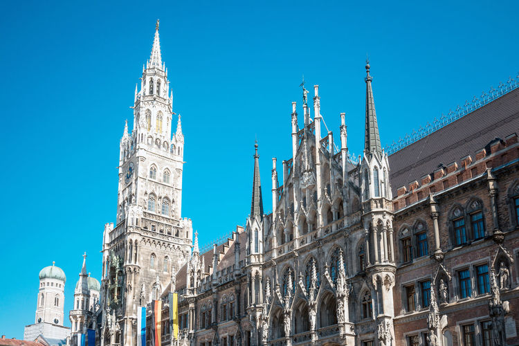 Architecture Blue Built Structure Capital Cities  City Clear Sky Culture Day Façade Famous Place High Section History International Landmark Landmark Low Angle View Marienplatz No People Outdoors Sky Tall - High Tourism Travel Destinations