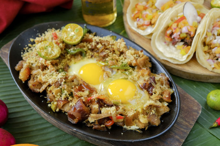 Food And Drink Food Egg Healthy Eating Ready-to-eat Freshness Meal Wellbeing Indoors  No People Meat Table Mexican Food Still Life Fried Egg Vegetable Rice - Food Staple Plate Close-up High Angle View Breakfast Egg Yolk Garnish Sisig