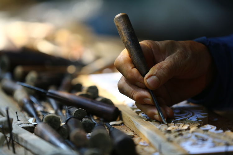 Close up of a man working on a wooden