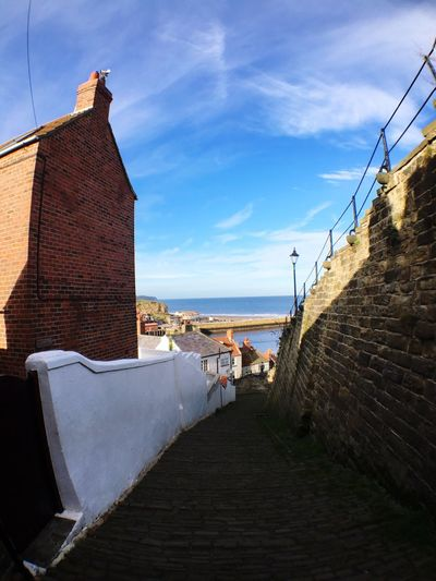 EyeEm Selects Built Structure Sky Sea Day Building Exterior Outdoors Water Whitby 199 Steps Whitby Going Down North Yorkshire Fisheye Fisheye Lens Cloud - Sky Wall The Way Forward Direction Leisure Activity Footpath Horizon Over Water Lifestyles