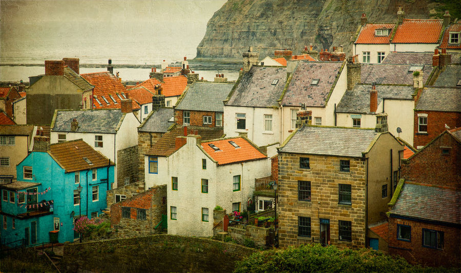 Staithes Fishing Port Cottage Rooftops Colourful Roofs Cottage Rooftops Fishing Port Houses North Yorkshire Seaside Port Staithes Architecture Building Exterior Built Structure Cliff Close-up Cottages Day England House No People Outdoors Residential Building Roof Rooftops Sea Seaside Village Windows