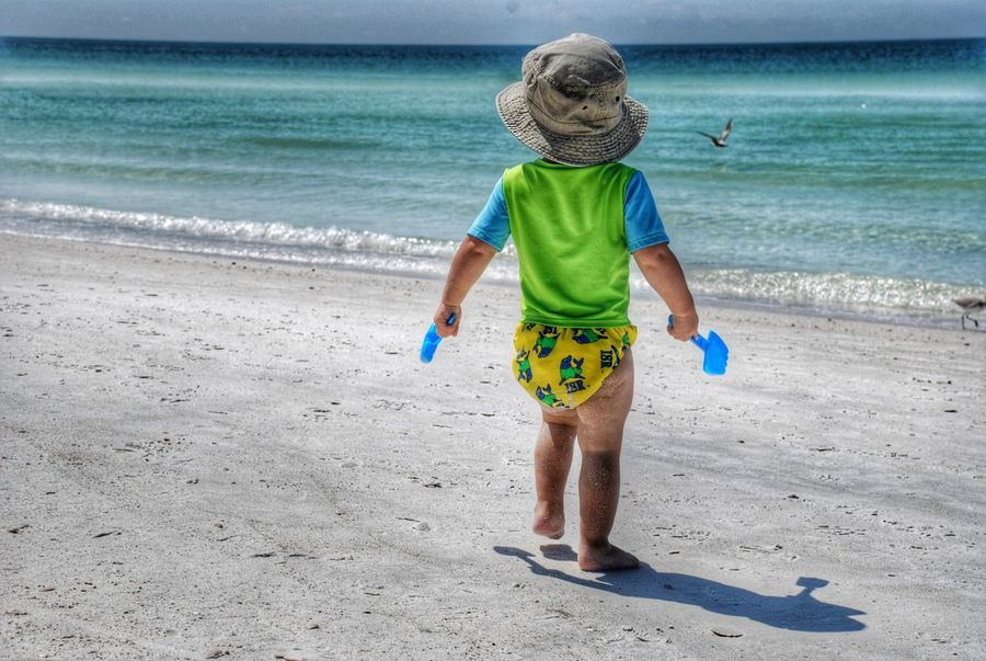 Beach Sea Sand Children Only Child Childhood Full Length One Person Horizon Over Water Outdoors People Water Nature Day Beach PhotographyBeach Life Beach Day Live For The Story Let's Go. Together. An Eye For Travel The Traveler - 2018 EyeEm Awards