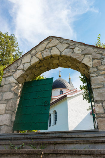 Gate of the Trinity Church, Russia, Polenovo Autumn Bekhovo Church Gate Russia Russia. Polenovo Tula Oblast Arch Architecture Building Exterior Built Structure Cloud - Sky Day Door Low Angle View No People Oka Orthodox Outdoors Polenovo Sky Tree