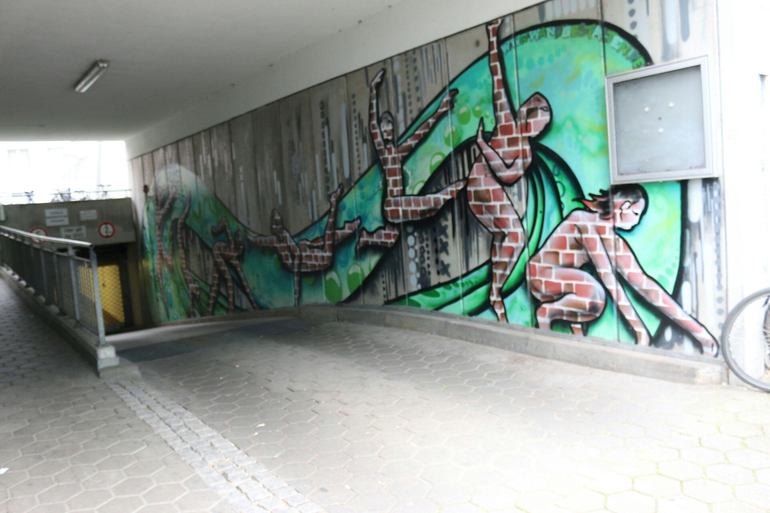 art, art and craft, creativity, indoors, architecture, built structure, graffiti, human representation, wall - building feature, animal representation, blue, sculpture, no people, railing, wall, statue, building exterior, street art