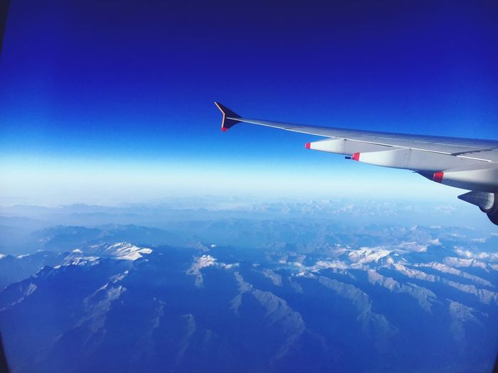 The Alps Windowview Airplane Singaporeairlines Early Morning Sky