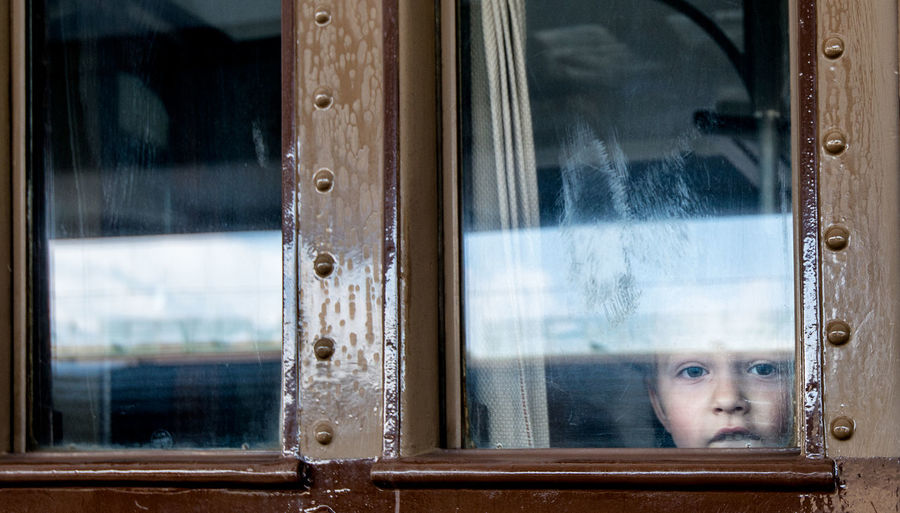 old train window with a child Child Child At The Window Glass - Material Little Child Little Child On Travel Old Train Old Train Window On The Way Train Train Windows Travelling Window Long Goodbye