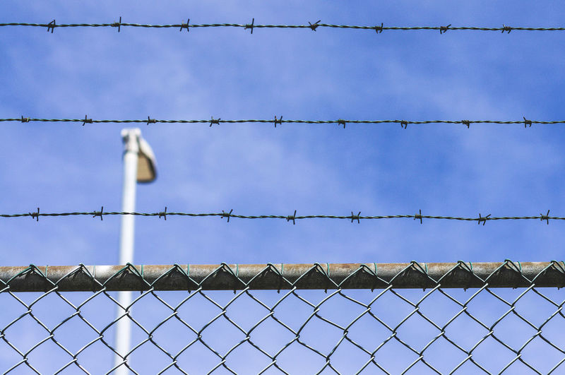 Barbed wire fence Freedom Architecture Barbed Wire Barrier Boundary Chainlink Fence Day Fence Metal No People Prison Protection Safety Security Sky Wire