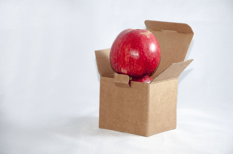 Apple Apple - Fruit Apples Apples In A Box Cardboard Box Close-up Food Freshness Indulgence No People Organic Red Still Life Studio Shot Telling Stories Differently White Background