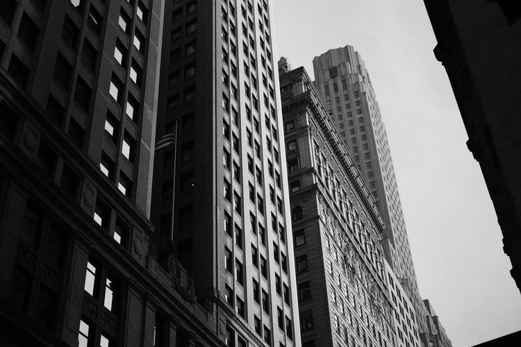 Wall street building, New York city Architecture Art Deco Building Exterior Built Structure City City Life Day Downtown District Financial District  Low Angle View Modern No People Outdoors Sky Skyscraper Welcome To Black