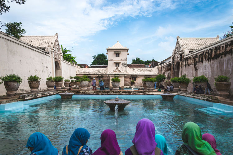 Re-Edit: The sultan's palace on Java, Indonesia. (Ancient outdoor bath with woman in the forground, wearing multi colored headscarfs) Ancient Fine ArtArchitecture ASIA Blue Sky Colorful Culture Cultures First Eyeem Photo Fountain Headscarf INDONESIA Java Multi Colored Muslim Old Ornamental Garden Outdoors Palace People Religion Religious  Sky Water Women Miles Away Women Around The World EyeEm Diversity BYOPaper! An Eye For Travel Visual Creativity