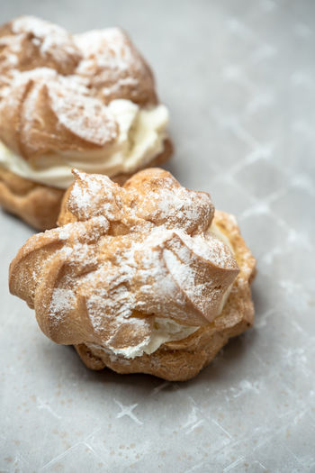 sweet, sprinkled with powdered sugar cream puffs Creamy White Sweet Food Puffs EyeEm Selects Bread Close-up Food And Drink Savory Pie Pie Pastry Prepared Food Baked Powdered Sugar Puff Pastry Baked Pastry Item Sprinkling Sweet Pie