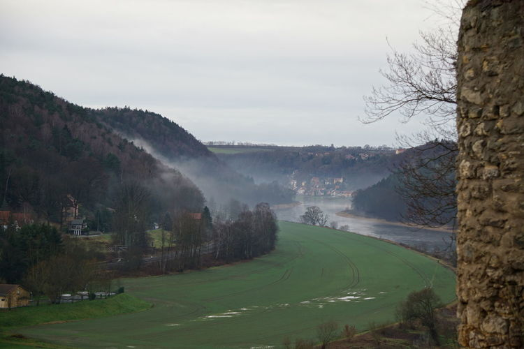 foggy weather in elbsandstein mountains with view to river elbe Elbe River Elbsandstein Gebirge Elbsandstein-Gebirge Elbsandsteingebirge Elbsansteingebirge Frog Frog Perspective GERMANY🇩🇪DEUTSCHERLAND@ Beauty In Nature Day Elbe Field Landscape Mountain Nature No People Outdoors Rural Scene Sachsen Scenics Sky Tranquil Scene Tranquility Tree Water