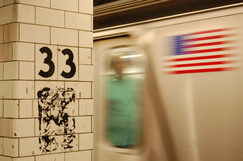 Blurred Motion Of Subway Train With American Flag