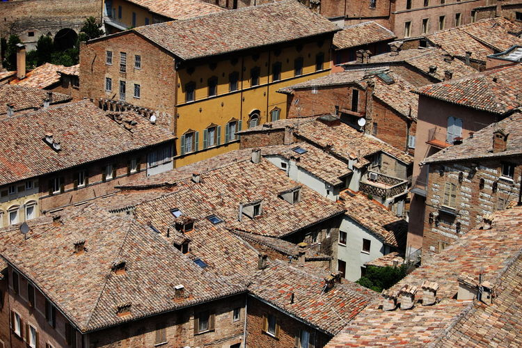 High angle view of old houses in town