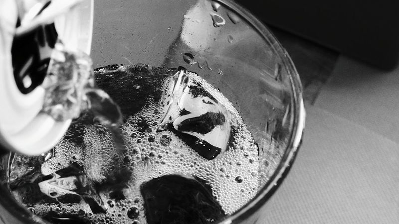 The Drinking Juice Ice Glass Glass - Material Drinking Glass Ice Cubes Bublles Macro Photography Eyeemblack&white Eye4photography  Black And White Photography Cascais Portugal Leisure Activity EyeEm Gallery