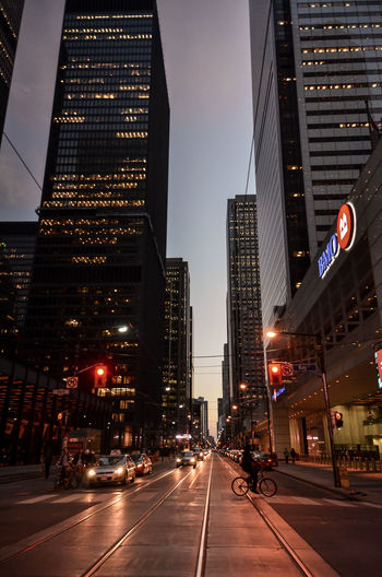 City street and modern buildings at night