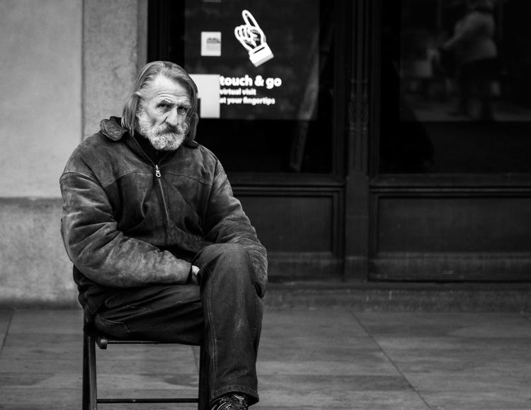 The owner of paintings siting outside Krakow Cloth Hall. Candid Portraits Christmas Market Krakow Eyecontact Krakow Market Square Market Square Real People Street Photography Street Portrait Streetphotography