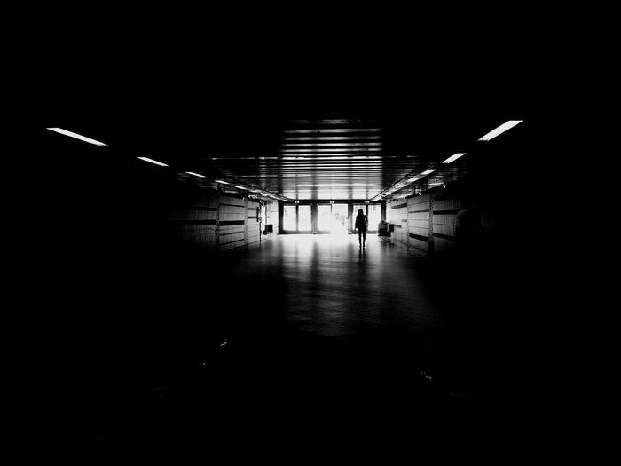 Silhouette man in illuminated room