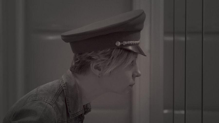 Side view of woman wearing cap looking away