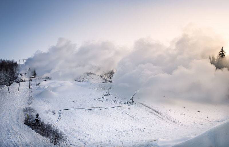 Landscape with snow cannons in ski slope Finland Blower Blue Cannon Cold Temperature Day Downhill Frost Hill Landscape Light Machine Machines Nature No People Outdoors Ski Slope Skiing Sky Snow Snowing Snowmaking Sunlight Winter Wintry