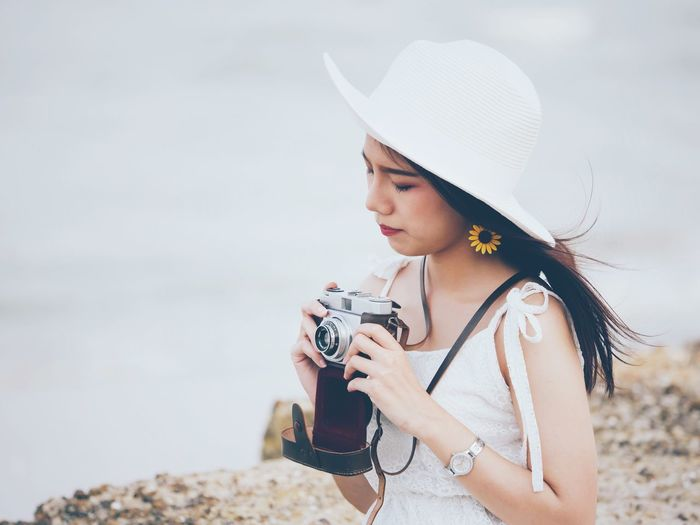 Camera - Photographic Equipment Photography Themes Beach Young Adult Old-fashioned One Person Outdoors Photographer Sea Beautiful People Young Women Leisure Activity Retro Styled Beauty Beautiful Woman Sky Women Nature Day Photographing