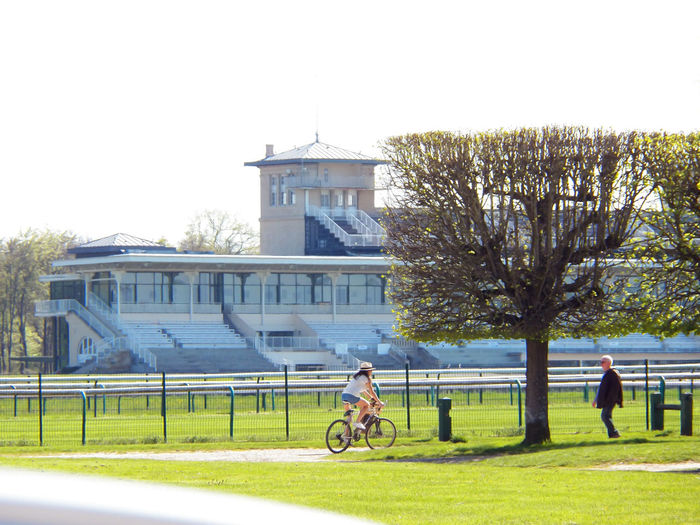 Racecourse hippodrome and bicycle by sunny day 🌞 Chantilly Hippodrome Cycling Activity Lovelyness Landscape Activity Adult Young Woman Cycling Woman And Hat City Tree French Peoples Girl Making Bike Leisure Activity Lifestyles Outdoors Tribune Path Way Architecture Glass Frontage Scenic View Hippodrome Tower Sunny Day 🌞 Champs De CourseHippodrome De France idyllic shoots In Chantilly, France