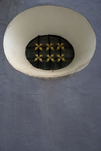 Close-up of circular object on wall