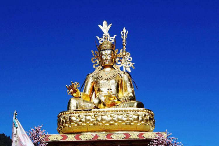 Blue Sky Golden Statue Buddha