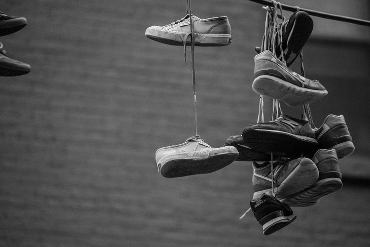 Shoe Hanging Pair No People Day Outdoors Sport The Photojournalist - 2017 EyeEm Awards The Street Photographer - 2017 EyeEm Awards Building Exterior Issakhari Power Lines Sneaker EyeEmNewHere Canon New York NYC Street Photography Lights And Shadows City Black And White Friday