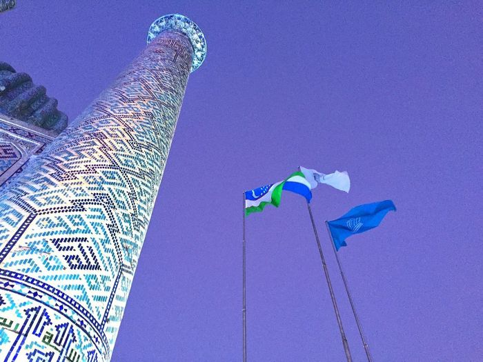 Magic moments of peace Colorful Building Exterior Building And Sky Architecture Travel Destinations History Uzbekistan Registansquare Flag The Graphic City Blue Low Angle View Day No People Outdoors Close-up