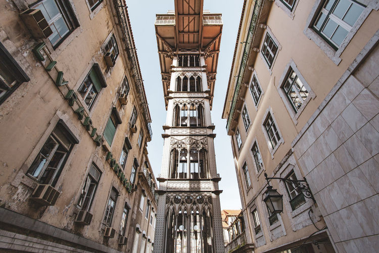 Lisbon Elevador De Santa Justa Elevator Architecture Building Exterior Built Structure Window Building Low Angle View City Residential District No People Day Old Outdoors History The Past Nature Town Time Travel Destinations Sky Sunlight Apartment