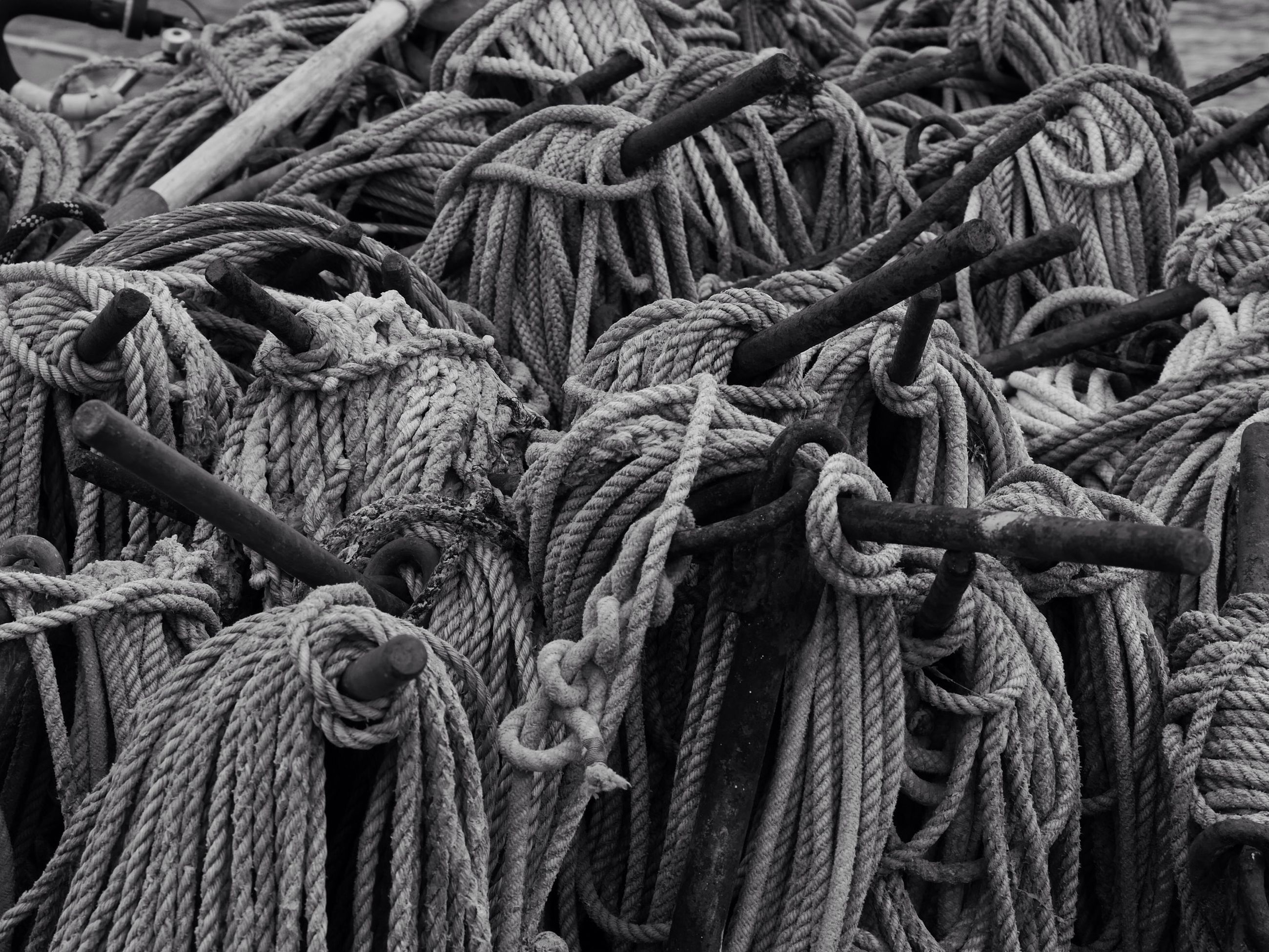 full frame, backgrounds, close-up, abundance, large group of objects, rope, metal, wood - material, textured, pattern, heap, stack, strength, rusty, detail, outdoors, no people, tied up, day, still life