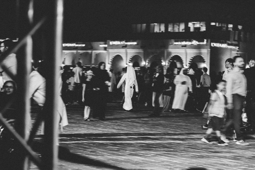 One focus Blurred Motion Walking Blackandwhite Thobe Arabian Qatar One Man Group Of People Real People Large Group Of People Transportation Women Crowd Adult Lifestyles Night City Men Public Transportation Architecture Walking Standing Street Leisure Activity Blurred Motion Built Structure The Still Life Photographer - 2018 EyeEm Awards