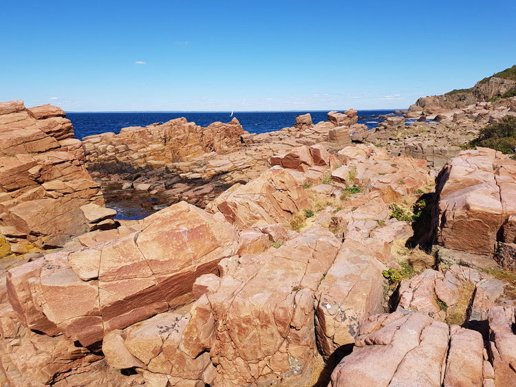 Landscape_Collection Summer Landscape Sky Blue Baltic Sea Water Horizon Over Water Hovs Hallar Sweden Beauty In Nature Photography Bildfolge Clear Sky Sunlight Rock - Object Sunny Extreme Terrain Blue Rock Formation Geology Rock Natural Arch Physical Geography Natural Landmark Rocky Coastline