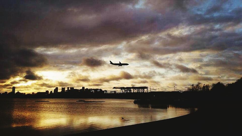 Flying Airplane Boston, Massachusetts Castle Island Journey Silhouette Cloud - Sky Sunset No People Outdoors Dramatic Sky Air Vehicle Power In Nature Travel Transportation Commercial Airplane Sky Nature Aerospace Industry Adventure Private Airplane Beauty In Nature