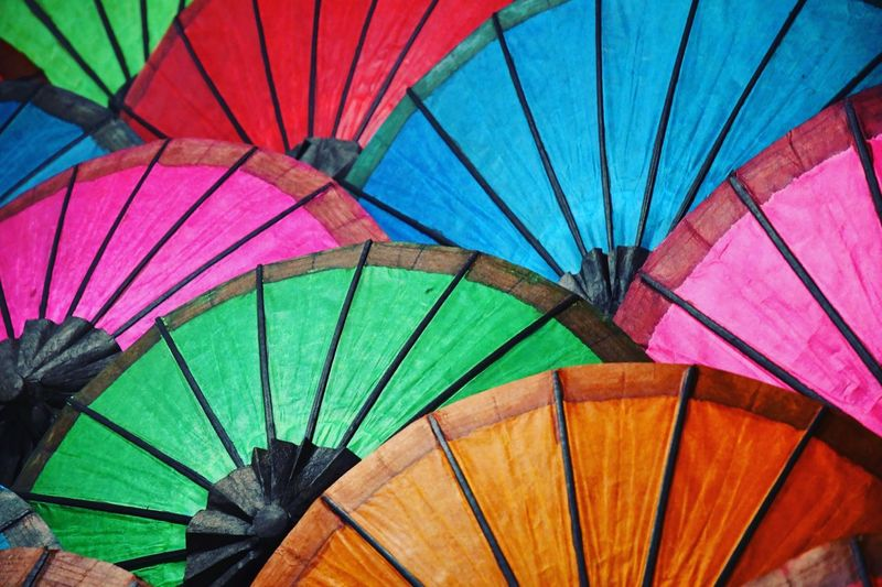 Low angle view of multi colored umbrellas in market