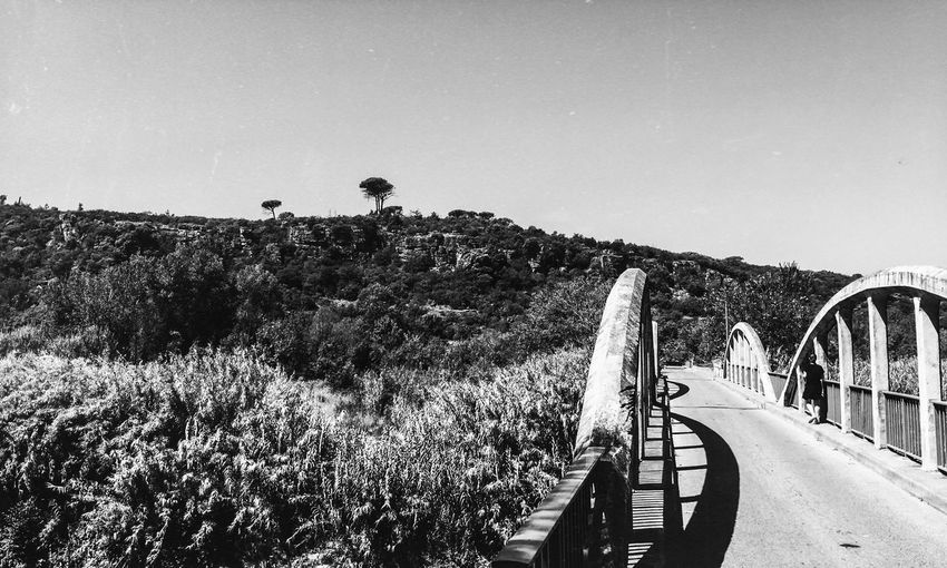 Panoramic view of bridge against clear sky