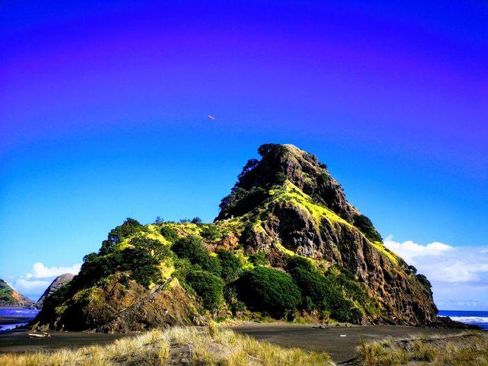 Te Piha on a fine day last week. Astronomy Mountain Blue Galaxy Rock - Object Mountain Peak Sky Landscape Rock Formation Volcano