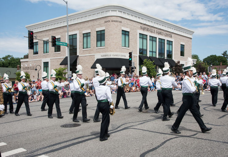 Naperville, Illinois, United States-May 29,2017: Waubonsie Valley High School marching in Memorial Day Parade with crowd in Naperville, Illinois Large Group Of People Crowd Street City March Marching Marching Band High School Students Waubonsie Valley In A Row Arts Culture And Entertainment Performance Musical Instrument Music Architecture Celebration Parade Clarinet Formation Order Turning Corner Skill  Uniform