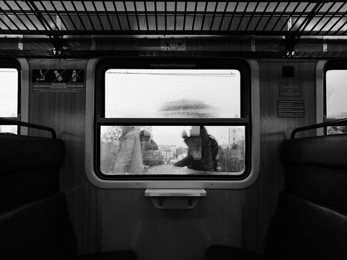 Wet window in train during rainy season