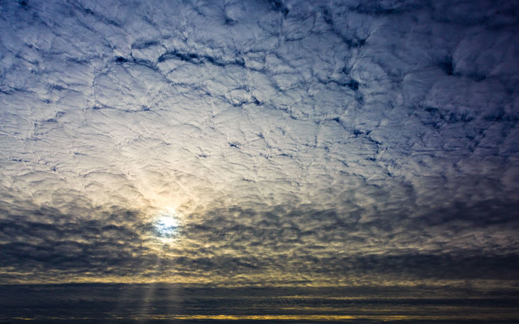 Sunrise behind cloud cover EyeEmNewHere Sky No People Nature Cloud - Sky Beauty In Nature Backgrounds Pattern Outdoors Full Frame Day Scenics - Nature