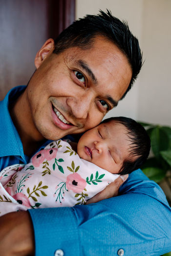 Portrait of father and baby