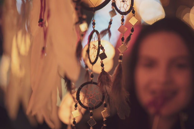Dreamcatchers Hanging Against Woman At Night