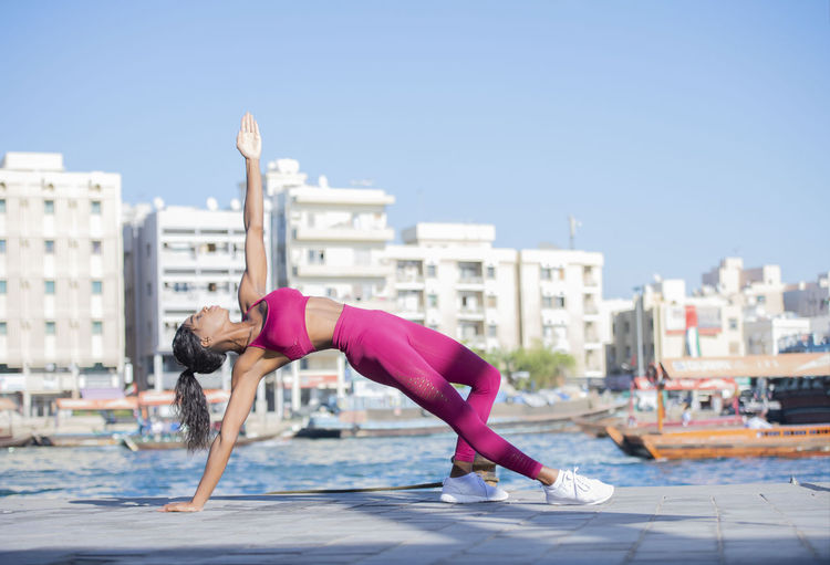 Woman exercising in city