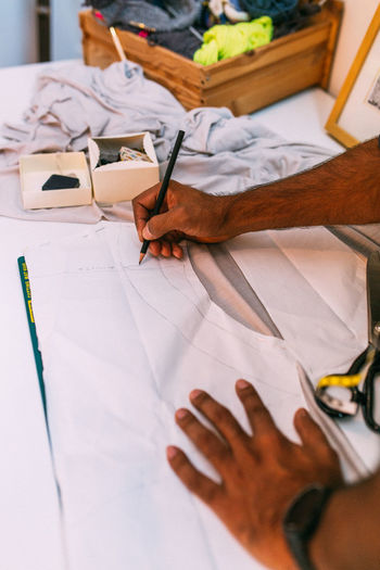 Adult Adults Only Close-up Creativity Day Design Professional Drawing Drawing - Activity Drawing - Art Product Fashion Designer Human Body Part Human Hand Indoors  Occupation Only Women Paper People Real People Sketch Sketch Pad Skill  Tailor Tailor Tailor Shop Working