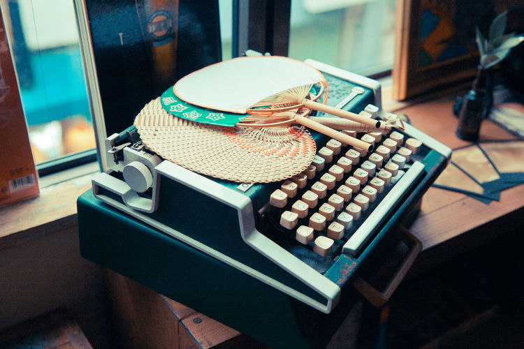 High angle view of hand fans on typewriter
